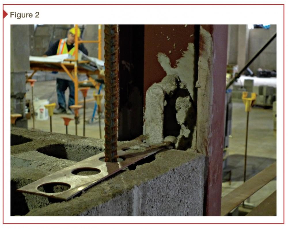 Rebar placed through hollow metal frame anchor for additional strength. Photos courtesy Ricci Greene Associates