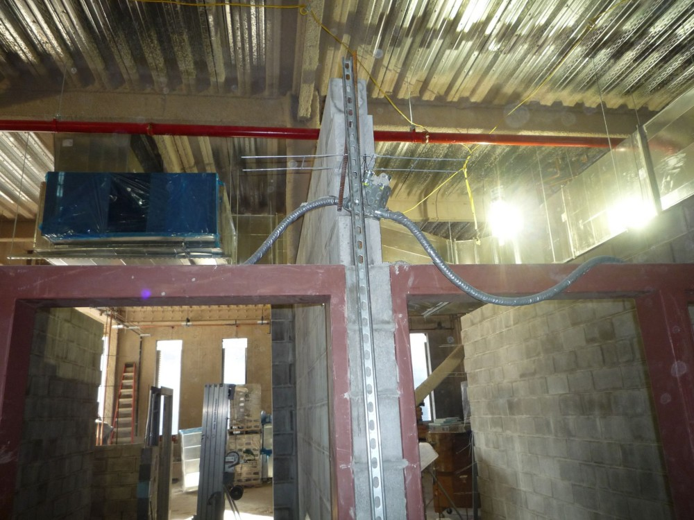 This photo shows a conduit waiting to be enclosed within the CMU walls. Photo courtesy Ricci Greene Associates