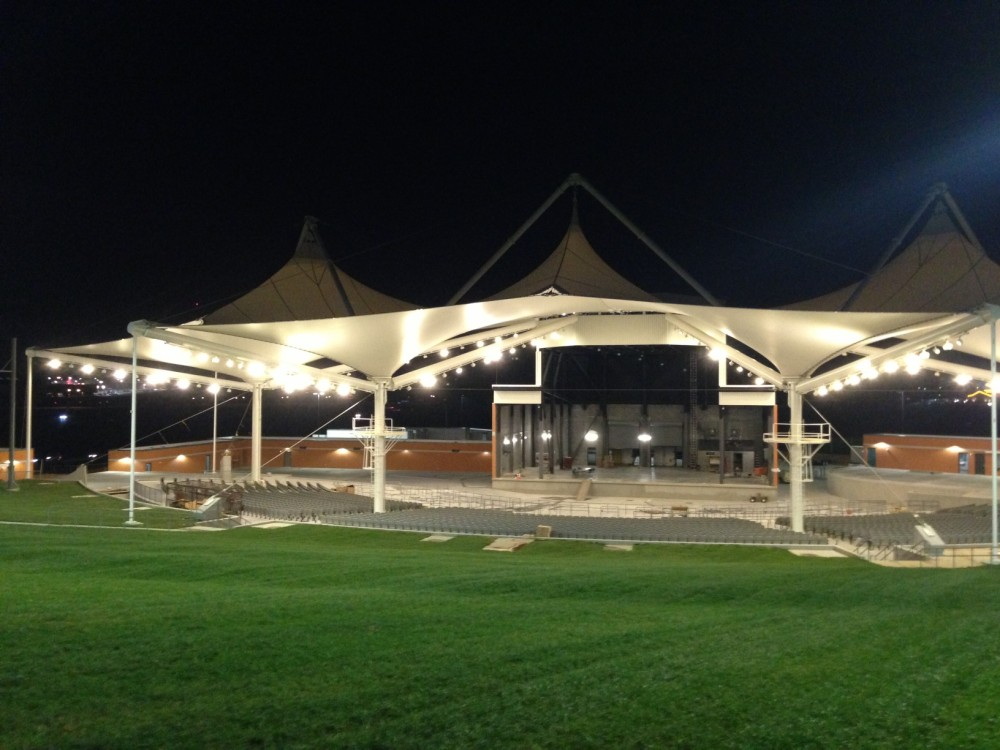 This photo shows a view of the Arkansas Music Pavilion at night. The polytetrafluoroethylene (PTFE) cone structures come to life with lighting, while at the same time protect concert attendees. Photos courtesy Birdair