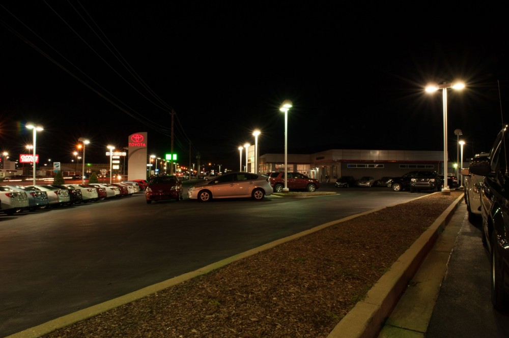 These photos show Gary Force Toyota's lot illuminated with traditional metal halide fi xtures. A total of 63 of the 1000- W fi xtures were replaced with 240-W light-emitting diode (LED) luminaries for dramatic energy savings.
