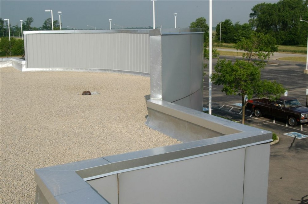 The photos above show a completed built-up roofi ng (BUR) system and light-colored gravel assembly.