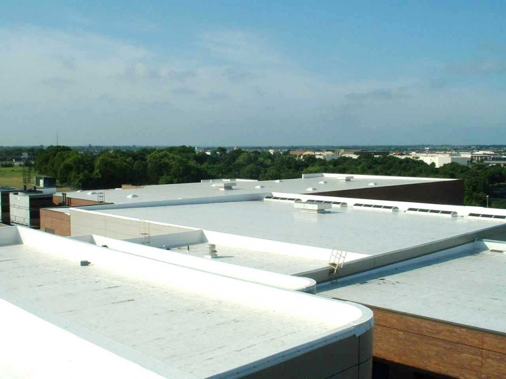 A white polyvinyl chloride (PVC) single-ply membrane provides a highly refl ective, cool roofi ng assembly.