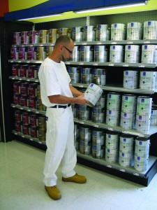 A professional is selecting paint for a project. Photo courtesy Sherwin-Williams