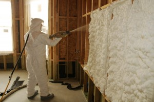 The installation of sprayfoam insulation in wood framed walls is shown here.