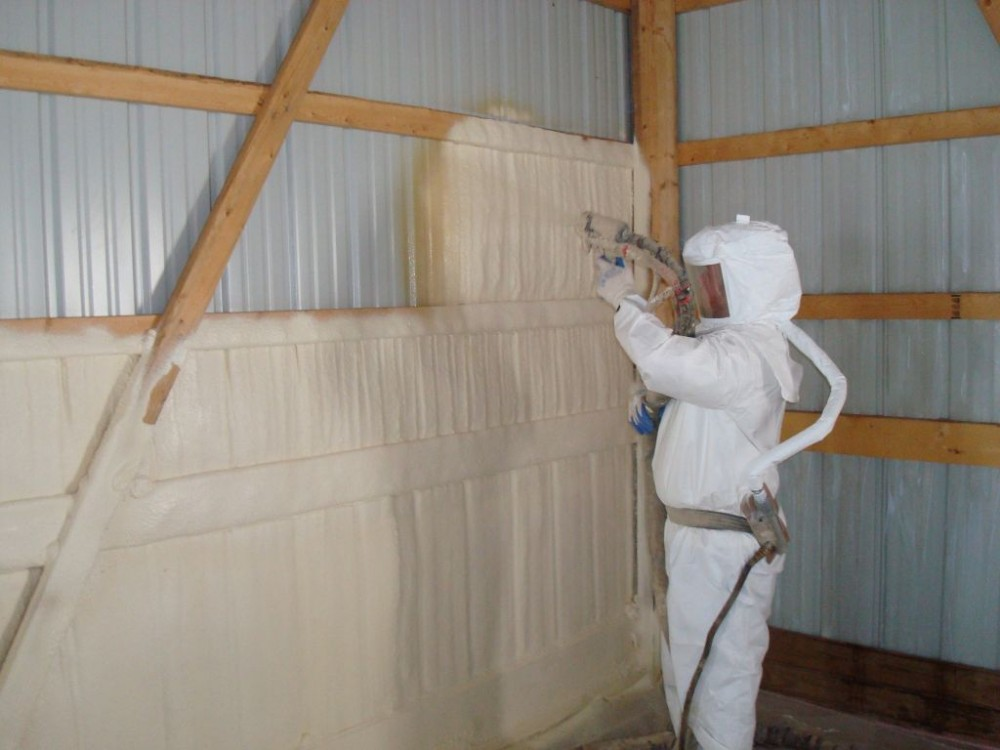 This photo demonstrates closed-cell SPF insulation applied inside a metal-clad building.