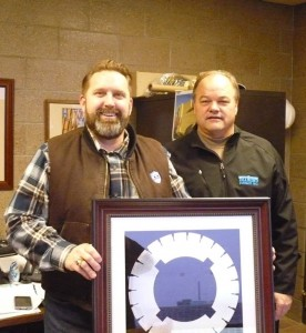 Senator John Pederson, Senate District 14 in Central Minnesota, receives the Government Official of the Year Award from IGGA's Terry Kraemer of Diamond Surface Inc.