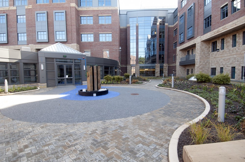 The healing garden is finished with ballasted stone, low vegetation and paver walkways.