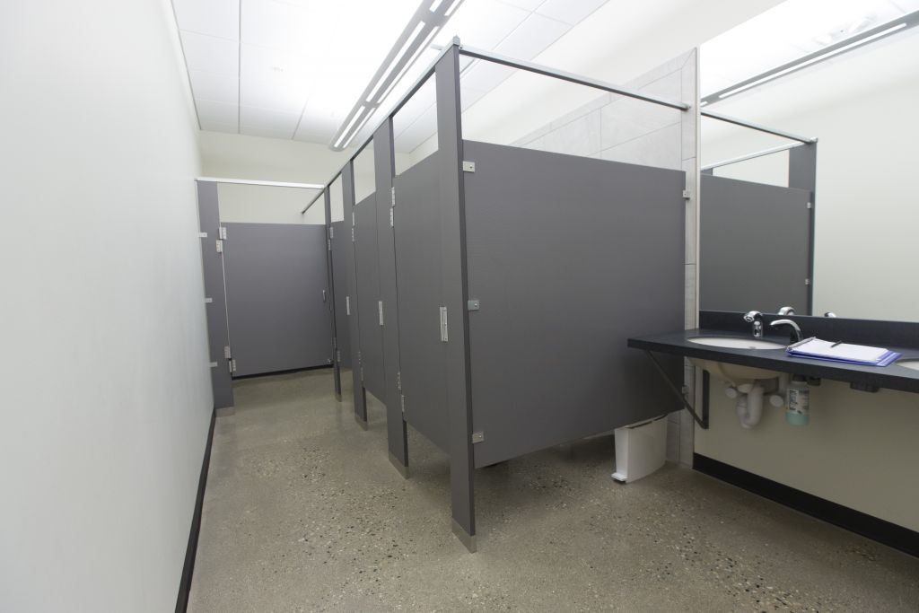 Restroom Partitions Complement School Expansion Construction Specifier - Solid plastic bathroom partitions