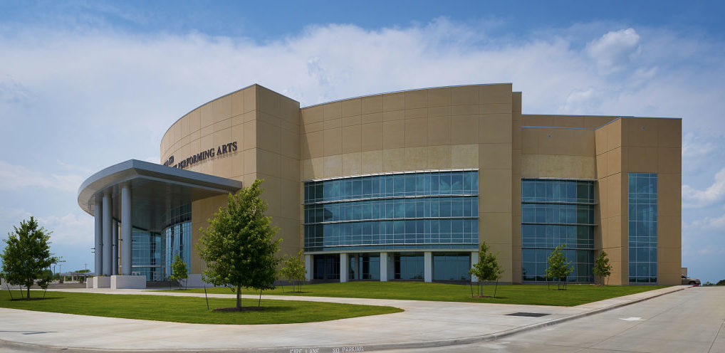Mansfield Center for Performing Arts in Texas features oversized entrances matched with large, curving spans of glass and aluminum storefront and curtain wall with sun shades. Photos courtesy Huckabee and Tubelite Inc.