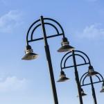 Modern light poles against a blue sky