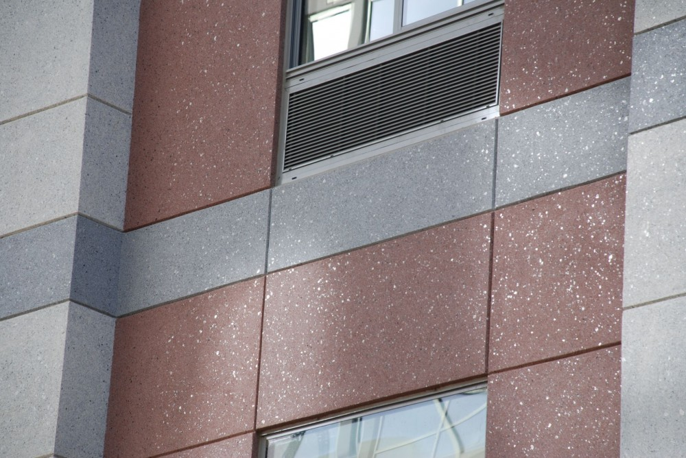 The picture is an example of a specialty finish replicating the look of granite using a ceramic bead, mica chips, and clear binder. This installation is on the Spring Hill Suites in Alexandria, Virginia.