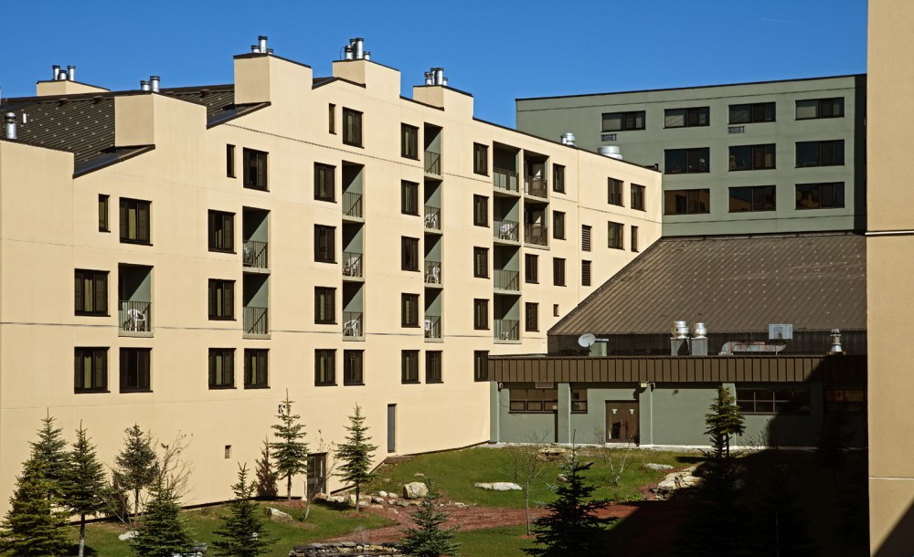 Silver Creek in Snowshoe, West Virginia, used an EIFS system which included a fluid-applied waterproofing air barrier to restore the high-rise resort. [CREDIT] Photos courtesy Sto Corp.