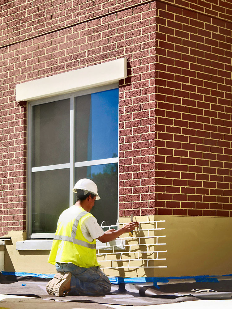 This photo shows a brick stencil applied to the substrate prior to the application of the EIFS finish. The stencil is removed before the finish dries to replicate the look of traditional brick. Photos courtesy Sto Corp.