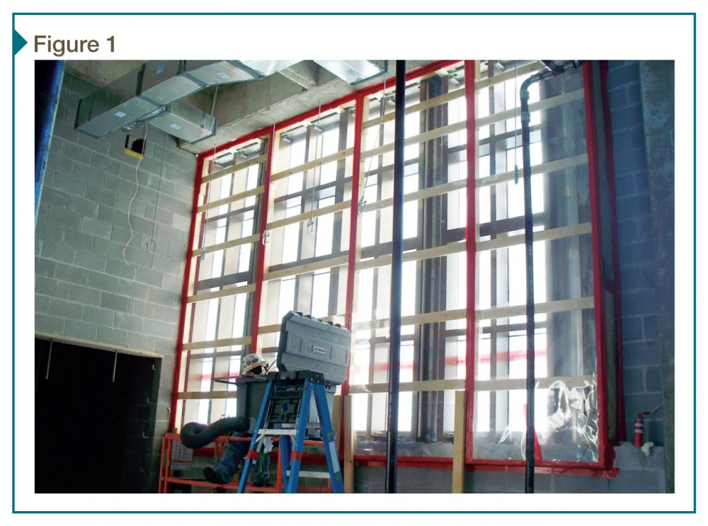 This site-built interior chamber creates differential pressure across a curtain wall system for a test under American Architectural Manufacturers Association (AAMA) 503, Voluntary Specification for Field Testing of Newly Installed Storefronts, Curtain Walls, and Sloped Glazing Systems.