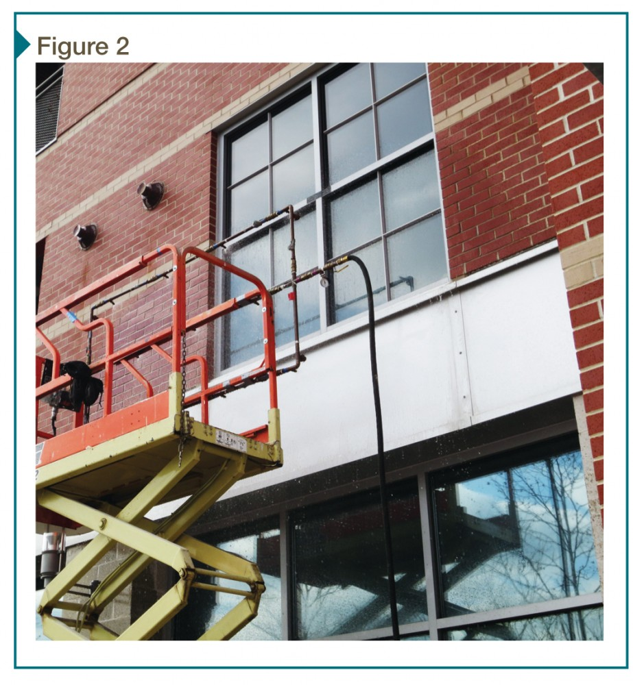 The spray rack above has been positioned on the window exterior for AAMA 502, Voluntary Specification for Field Testing of Newly Installed Fenestration Products.