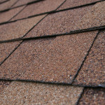 closeup detail of brown composition roof shingles
