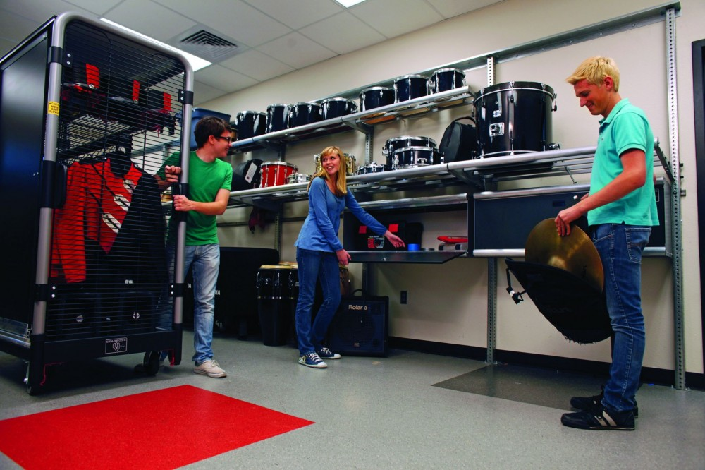 In Hart High School's (Santa Clarita, California) percussion and uniform rooms, adjustable shelving adapts to changing needs. Wheeled carts store and transport the marching band uniforms.
