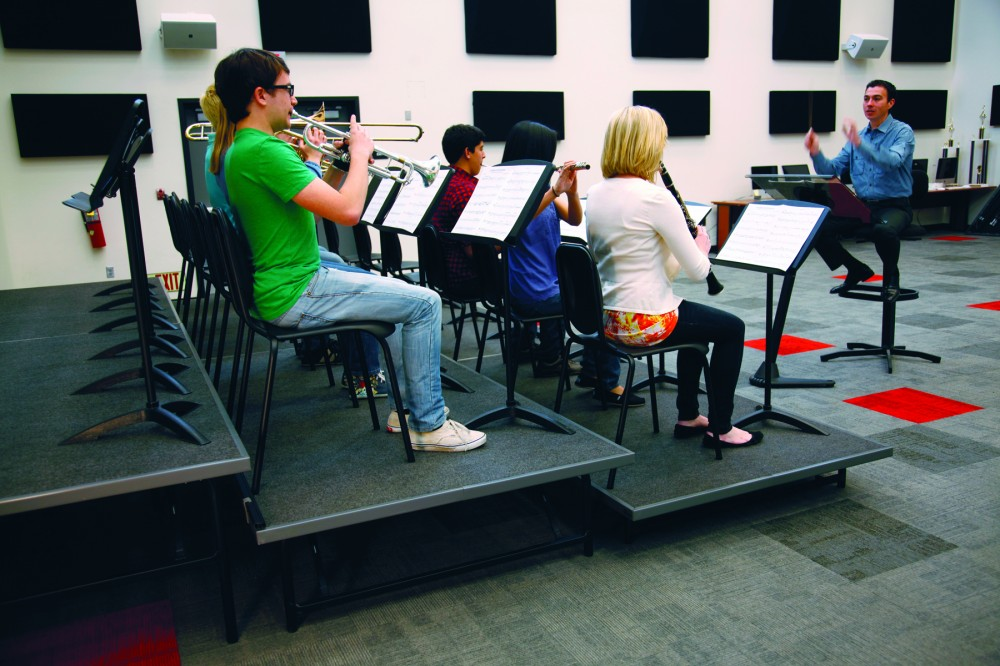 When the space under portable risers is left open, they do not diminish a rehearsal room's overall cubic volume. Portable risers also enable a flat floor for other activities.