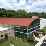The new Western Health Center (Midfield, Alabama) is a two-story facility that features proprietary mechanically seamed 50-mm (2-in.) metal roofing panels. Photo courtesy Petersen Aluminum
