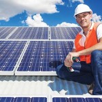 bigstock-Solar-Panels-With-Technician-69565381