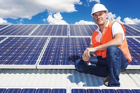 bigstock-Solar-Panels-With-Technician-69565381