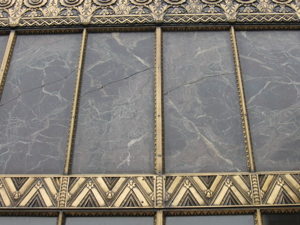 This existing marble at the main entrance was replaced in the ornamental brass framing.