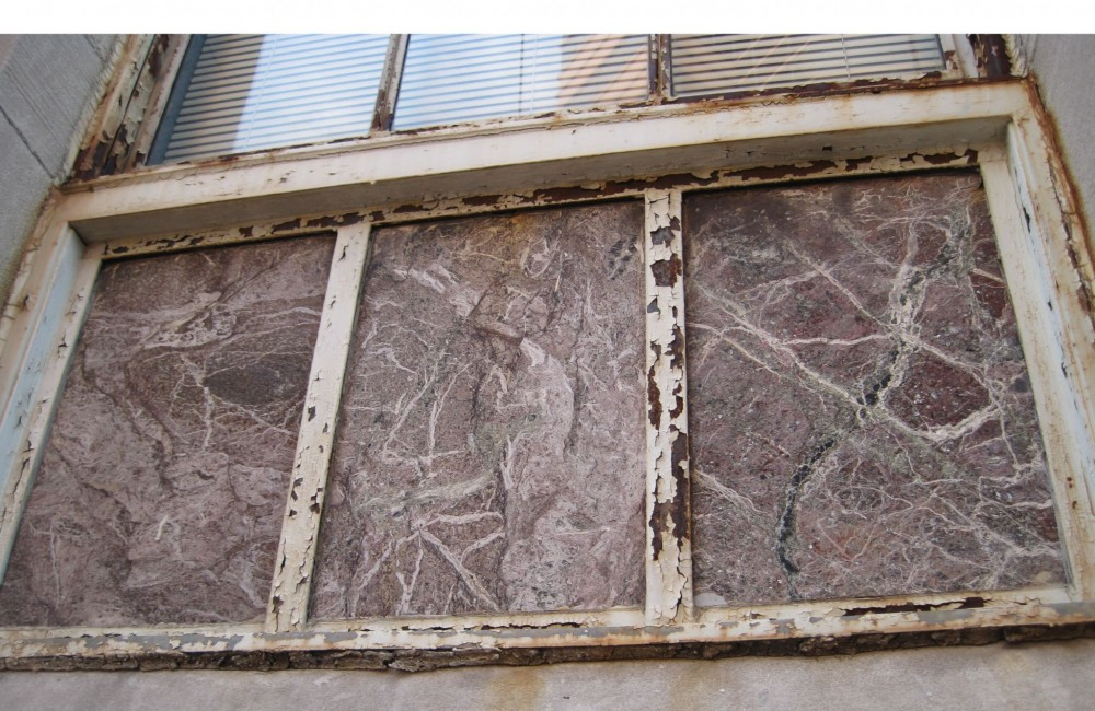 This is the original marble in the framed opening. Not only is there a crack in the panel to the right along one of the natural soft veins in the stone, but the marble had also lost its luster and burgundy color.