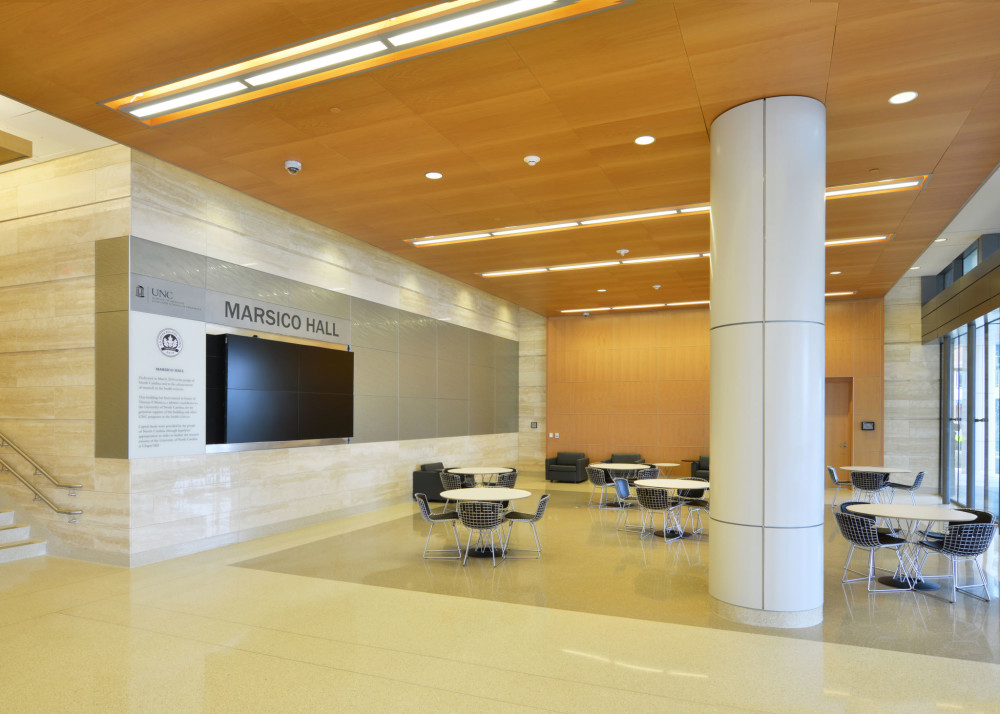 The main lobby of the University of North Carolina's Marsico Hall at Chapel Hill comprises 717 m2 (7715 sf) of plain sliced steamed beech veneered ceiling panels. Photo by David Ryan.