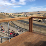 A railing system comprising stainless steel, aluminum, and cables allow spectators at the Sonoma Raceway to enjoy unobstructed views of all the action. Photo courtesy Feeney Inc.
