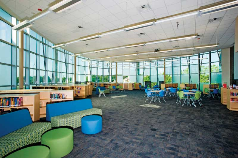 Daylighting elements, as shown here in the library, allow the facility to reduce heating and lighting costs, attributing to its net-zero rating. It was built to achieve Gold under Leadership in Energy and Environmental Design (LEED). Photos courtesy Fabral