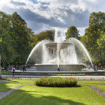 WARSAW, POLAND - SEPTEMBER 27, 2015: Historic fountain in Saski park (Saxon Garden). The fountain is the centerpiece of gardens and one of most precious urban symbols of Warsaw.