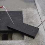 As the industry experiences high numbers of hazards and injuries when using traditional steel and other metal products for conventional access covers, it is turning to safer alternatives, such as composite materials.  Photo courtesy Fibrelite