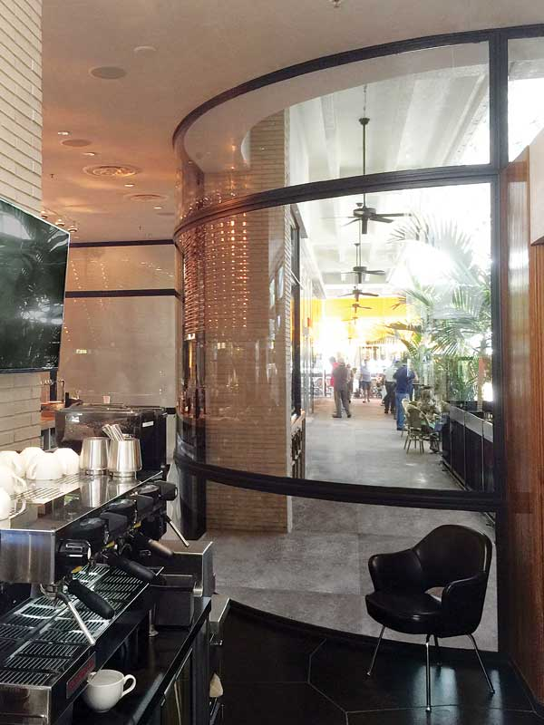 This interior curved on-plane glass in a restaurant, The Grill at Bal Harbour, is 4-m (13-ft) wide and 3.6-m (12-ft) high. The assembly was made possible due to the hot-rolled steel framing. Photo courtesy Dencon Architectural