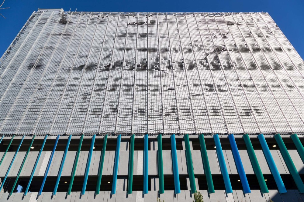 The façade of Boston Logan International Airport's new 10-story West Garage Extension comprises more than 48,000 aluminum flapper panels that move with the wind. Photos courtesy EXTECH and Linetec.