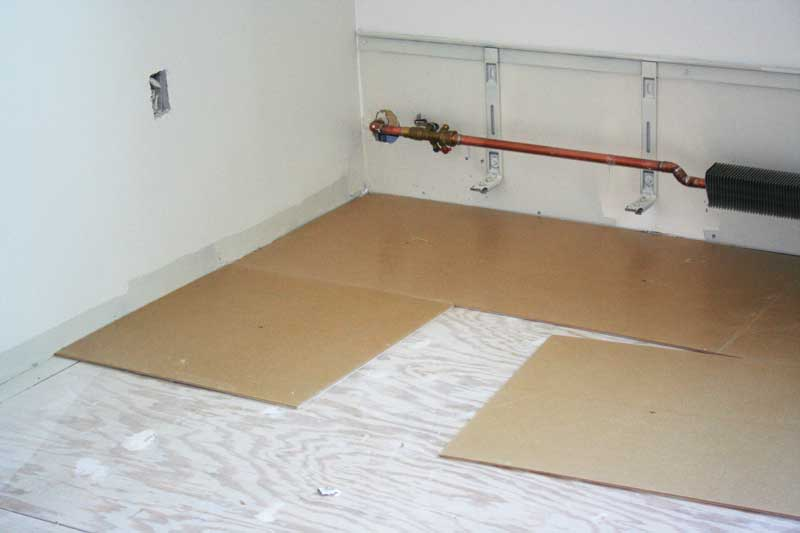 This system is applied in blocked sections to provide a calibrated surface board as the underlayment. It will then be covered by a glue-down floorcovering. Photos courtesy SoundSeal
