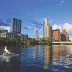 Austin Skyline with kayaker  dog