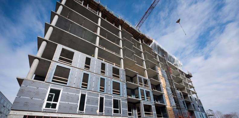 Integrated continuous insulation (ci) wall systems can eliminate construction steps, increase assembly speed, decrease construction costs, and reduce the number of materials needed. Photos courtesy Dow Building Solutions