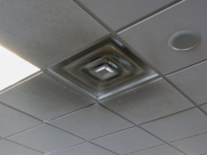 Soot from jet fuel exhaust can darken ceilings in airport terminals. Hygienic panels would simplify cleaning. Photo courtesy Michael Chusid