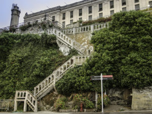 The seven participants of the Concrete Preservation Institute's (CPI's) field school this fall were tasked with restoring the staircase of the main cell house on Alcatraz Island. Photo courtesy BASF