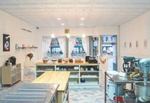 A decorative hygienic ceiling was used throughout this cupcake bakery to visually unify the food preparation and dining areas. Photo courtesy Ceilume