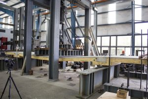 Full-scale testing of composite timber floor system at Oregon State University. Test at 800 percent service loads.