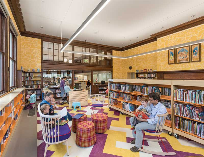 A gypsum board ceiling suspended on resilient clips with sound-absorbing batt insulation in the ceiling plenum was employed to achieve sound isolation at the Children's Reading Room at The Jamaica Plain branch of the Boston Public Library, Massachusetts. Photo © Anton Grassl. Photo courtesy Utile