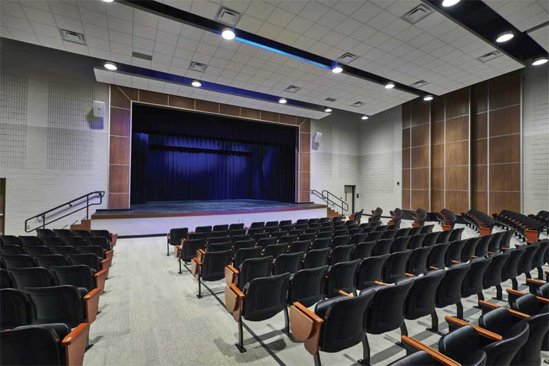 Premium composite panels with 0.90 noise reduction coefficient (NRC) and 42 ceiling attenuation class (CAC) contain sound and decrease reverberation for optimum sound quality in the Mill Creek Elementary auditorium in Tennessee while maintaining a consistent look throughout the building's gathering spaces.