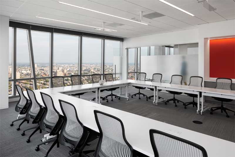 Mineral fiber panels with balanced sound absorption and sound-blocking capabilities control background sound within and prevent sound leakage from the FMC Corporation conference room.