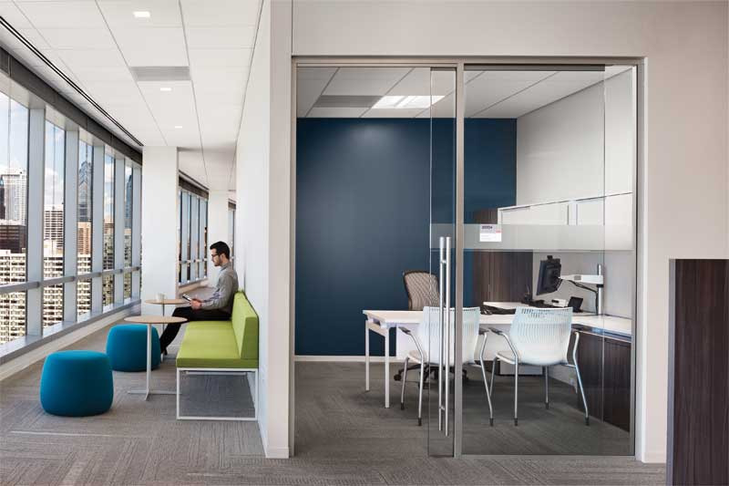 In the open corridor work area, 0.95 NRC fiberglass panels provide maximum sound absorption but are virtually indistinguishable visually from the mineral fiber panel (0.70 NRC, 33 CAC) featured in the enclosed office at FMC Corporation.