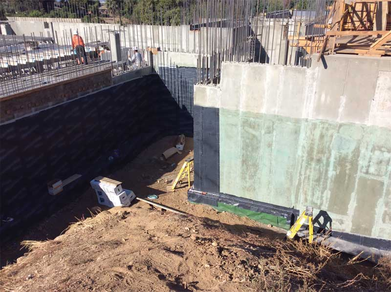 Figure 2: An often forgotten detail is the tie-in from below-grade waterproofing to under slab/footing vapor barrier.