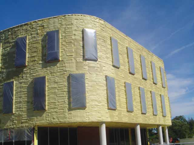 Closed-cell spray foam installed on building radius as continuous insulation (ci), air barrier, weather-resistive barrier (WRB), and vapor retarder. Photos courtesy Icynene-Lapolla