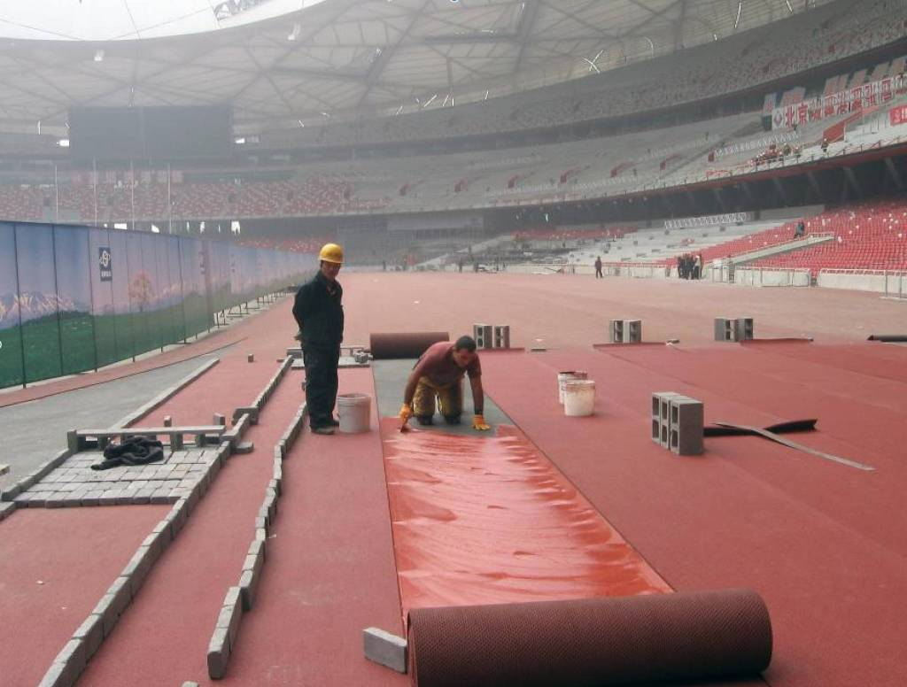 MAPEI's ADESILEX G19 two-component epoxy-polyurethane adhesive was used to adhere the rubber track at Beijing's National Stadium in preparation for the 2008 Olympic Games.