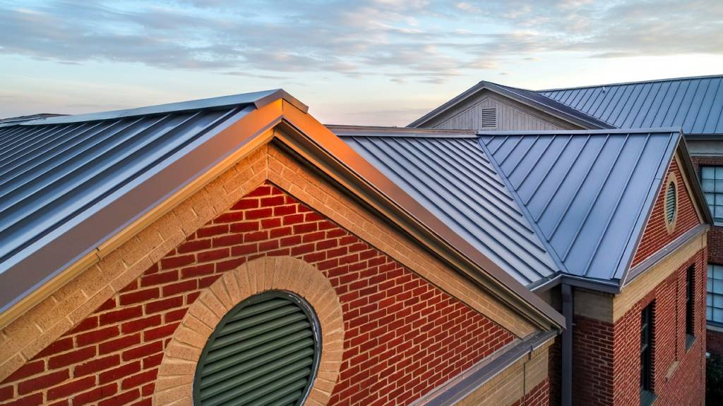Designed specifically for retrofit applications, the metal panel roofing system installed at Alexander II Magnet School in Macon, Georgia, was applied without the need for an underlayment or tear-off. Photos courtesy McElroy Metal
