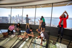 Space Needle guests enjoy The Loupe, the world's first revolving glass floor. Photo courtesy Space Needle